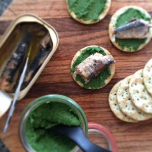 Sardines on crackers with nettle-walnut butter